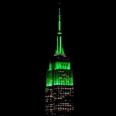 "Empire State Building is lit green on Monday to celebrate the exhibition ""Making Marvels"" at the Met."