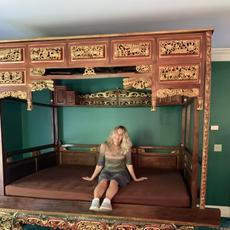 An auction standout is this over-the-top Chinese opium bed ($500-5,000) that is elaborately decorated and carved, measuring 100 inches tall.