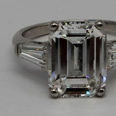 Sparking amid a bevy of fine jewelry pieces is this platinum engagement ring set with a central 5.25-carat emerald-cut diamond flanked by tapered baguettes ($30/50,000).