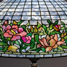"TIFFANY STUDIOS, ""PEONY BORDER"" FLOOR LAMP, CIRCA 1910.  SOLD FOR $137,000."