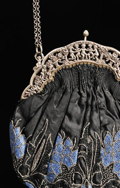 Beaded black silk purse with silver hardware, America, circa 1900