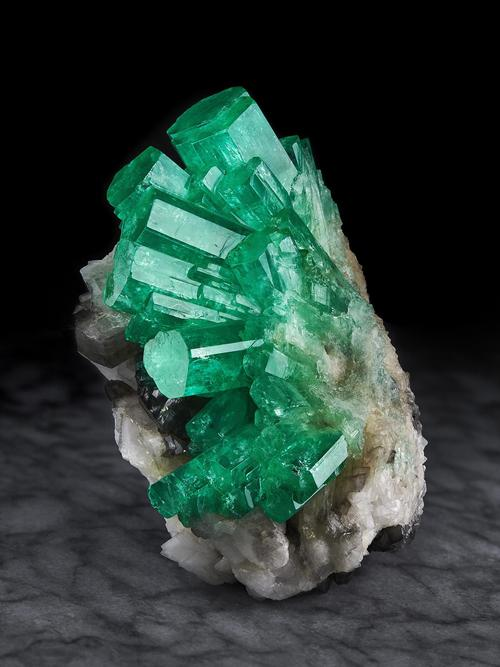 Emerald on Calcite, Coscuez Mine, Muzo Municipality, Vasquez-Yacopí mining district, Boyacá Department, Colombia.  9 cm height.  (currently in the collection of the Rice Northwest Museum)