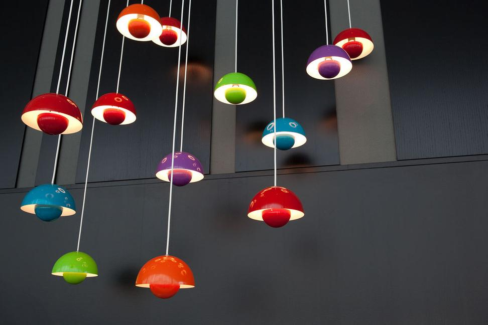 Greenery recalls the 1960s Danish modern design aesthetic that includes a shade in Verner Panton's Flowerpot lamps.
