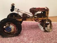 It opened with the melancholy reflection that, in the lives of mortals, the best days are the first to flee.  Vintage General GG tractor, fur, paper, acrylic, oil, 72x120x54 inches, Installation at Goucher College, Baltimore, MD, 2018