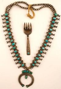 Vintage mini squash blossom necklace with all hand-stamped and formed squash blossoms set with turquoise stones, crafted circa the 1940s, with small fork ($8,125).
