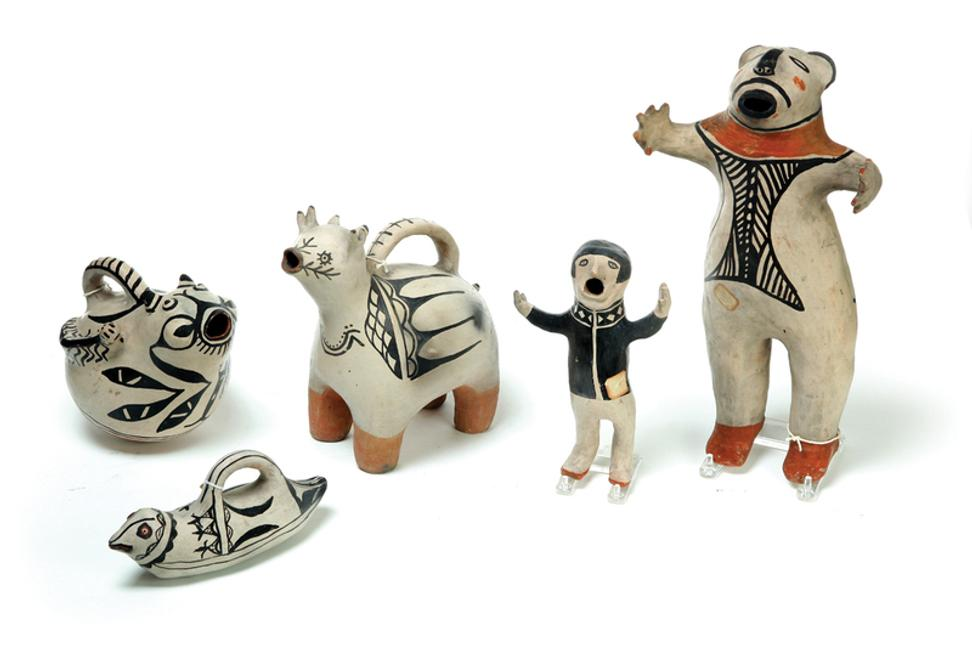 The top lot of Garth's March 11-12 Americana auction is pictured at far right.  The large Cochiti effigy figure sold for $17,625.