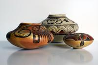 "Photo by Bill Dambrova.  Ceramics (L-R): Nampeyo (Hopi/Tewa, c.  1860-1942), ""Unchained Melody Jar,"" c.  1905-1907, and ""Polychrome Storage Jar with Appliqué,"" c.  1905; Les Namingha (Hopi/Zuni, b.  1967), ""Jar,"" c.  1997.  Gifts of The Allan and Judith Cooke Collection."