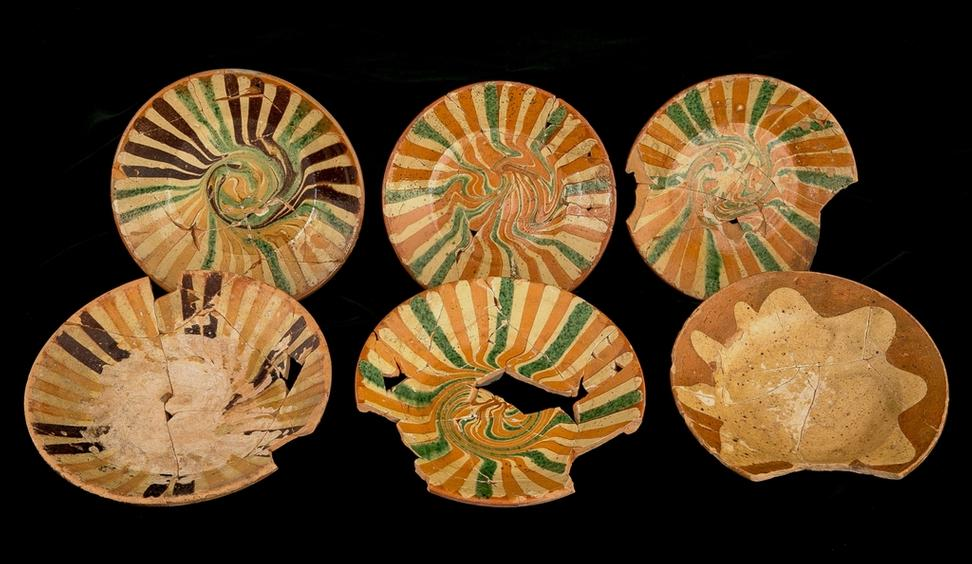 Decorative items from a remarkable assemblage of 18th-century slipware ceramics uncovered during an archaeological excavation in Philadelphia.  Photo courtesy of Robert Hunter