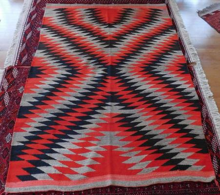 Transitional Navajo weaving made of wool and dye in New Mexico in the 1890s, boasting multiple colors and 95.5 inches by 70 inches (est.  $3,500-$7,000).