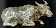 Bronze recumbent buffalo inlaid with silvery phoenix motifs accented with incised Leiwen