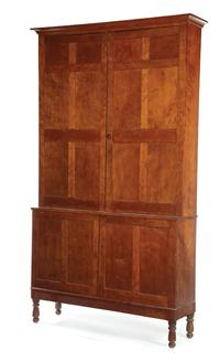 A one-piece cherry and poplar cupboard, possibly by Richard Rood of Marietta, Ohio, ca.1830, brought $16,450.